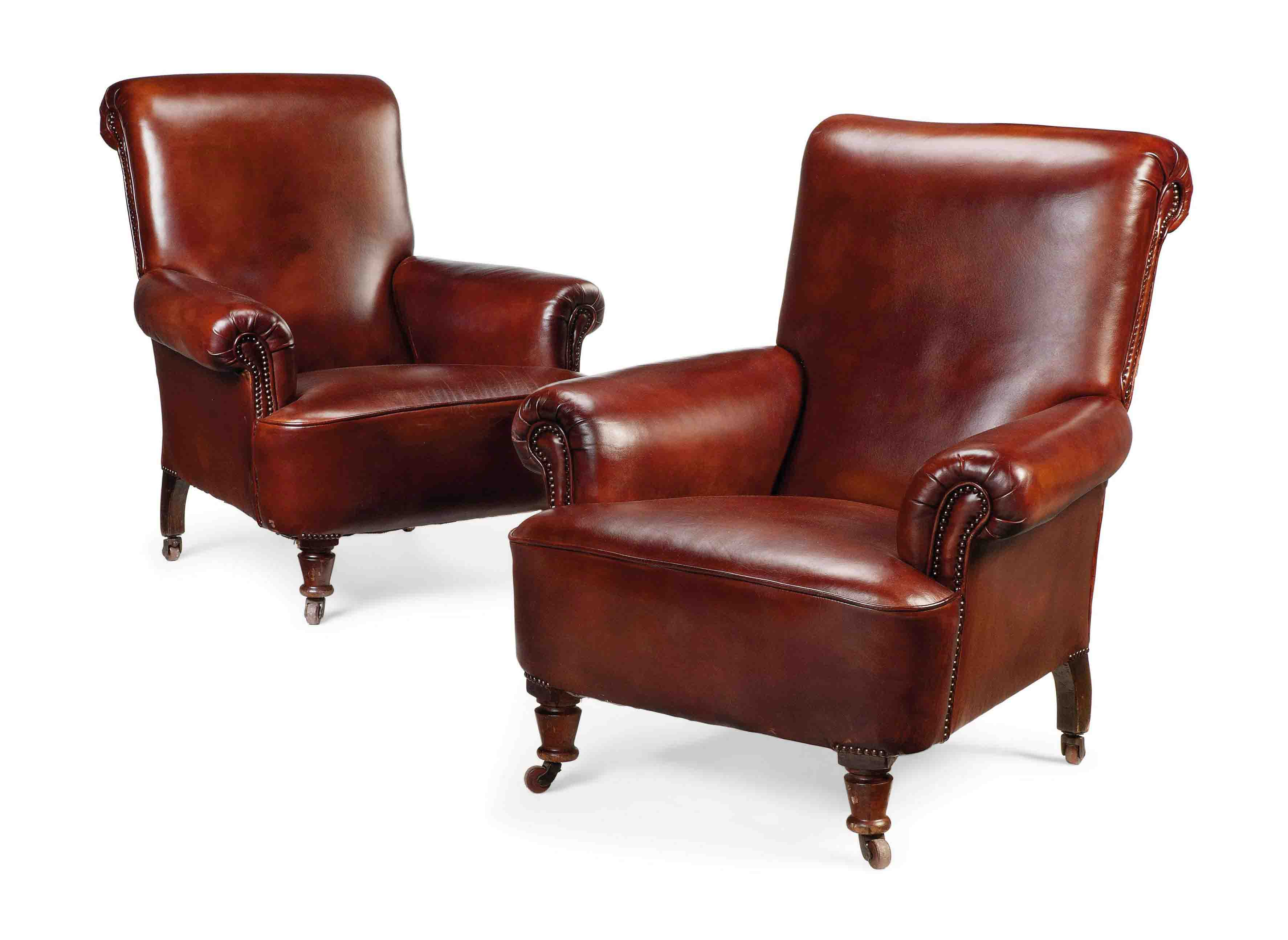 A PAIR OF LATE VICTORIAN LEATHER CLUB ARMCHAIRS