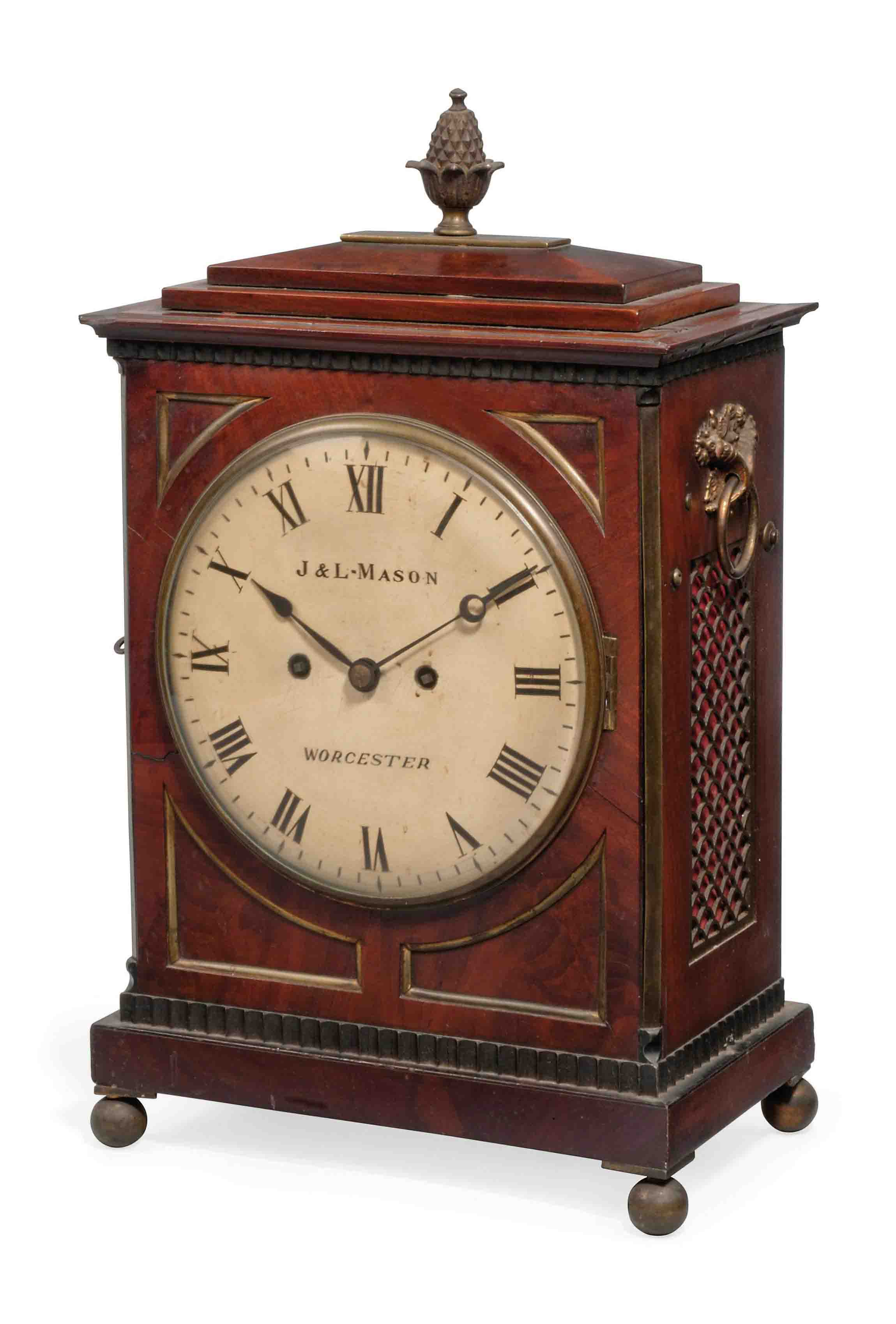 A REGENCY MAHOGANY AND BRASS-MOUNTED EIGHT DAY STRIKING TABLE CLOCK