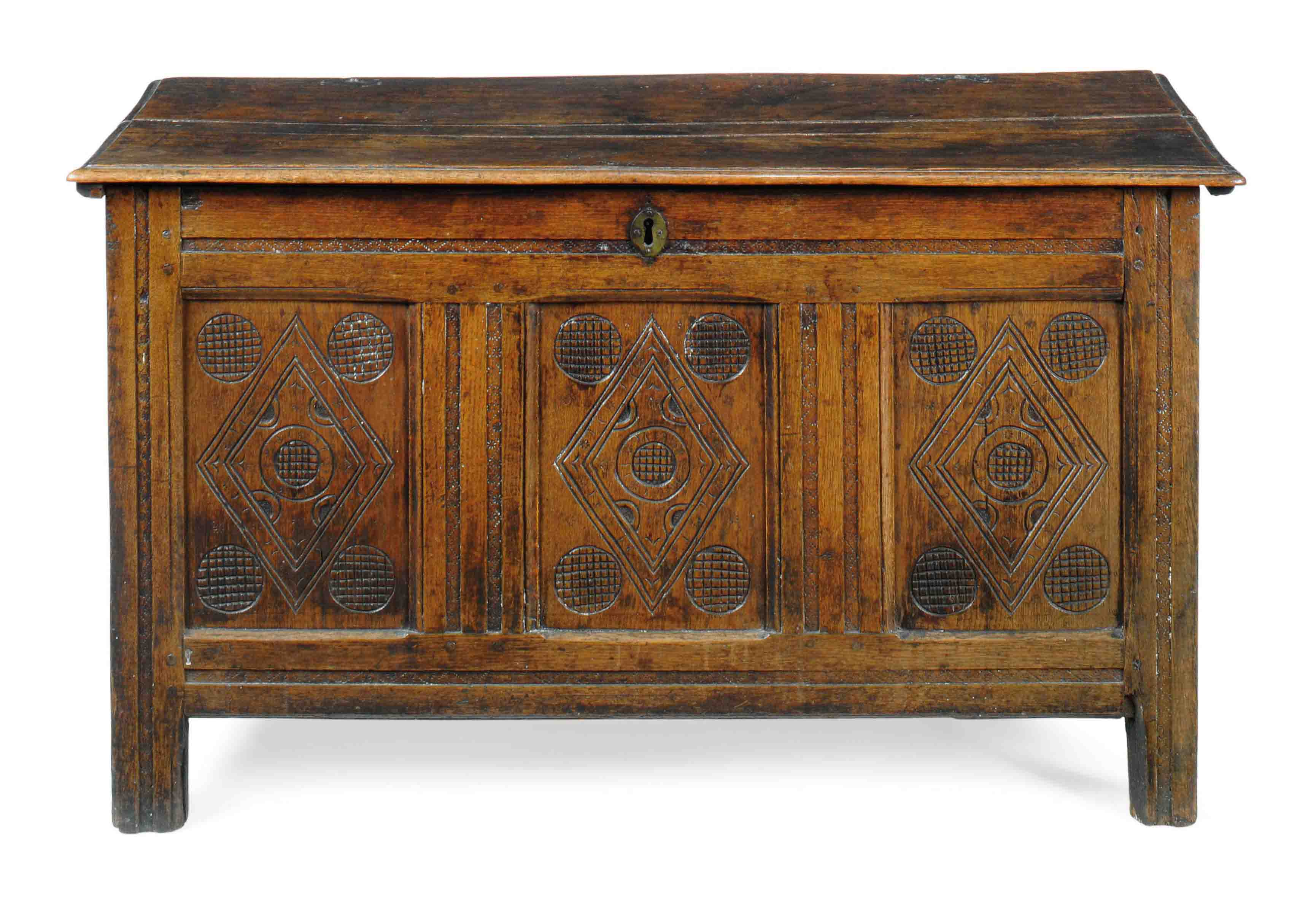 AN ENGLISH CARVED OAK COFFER