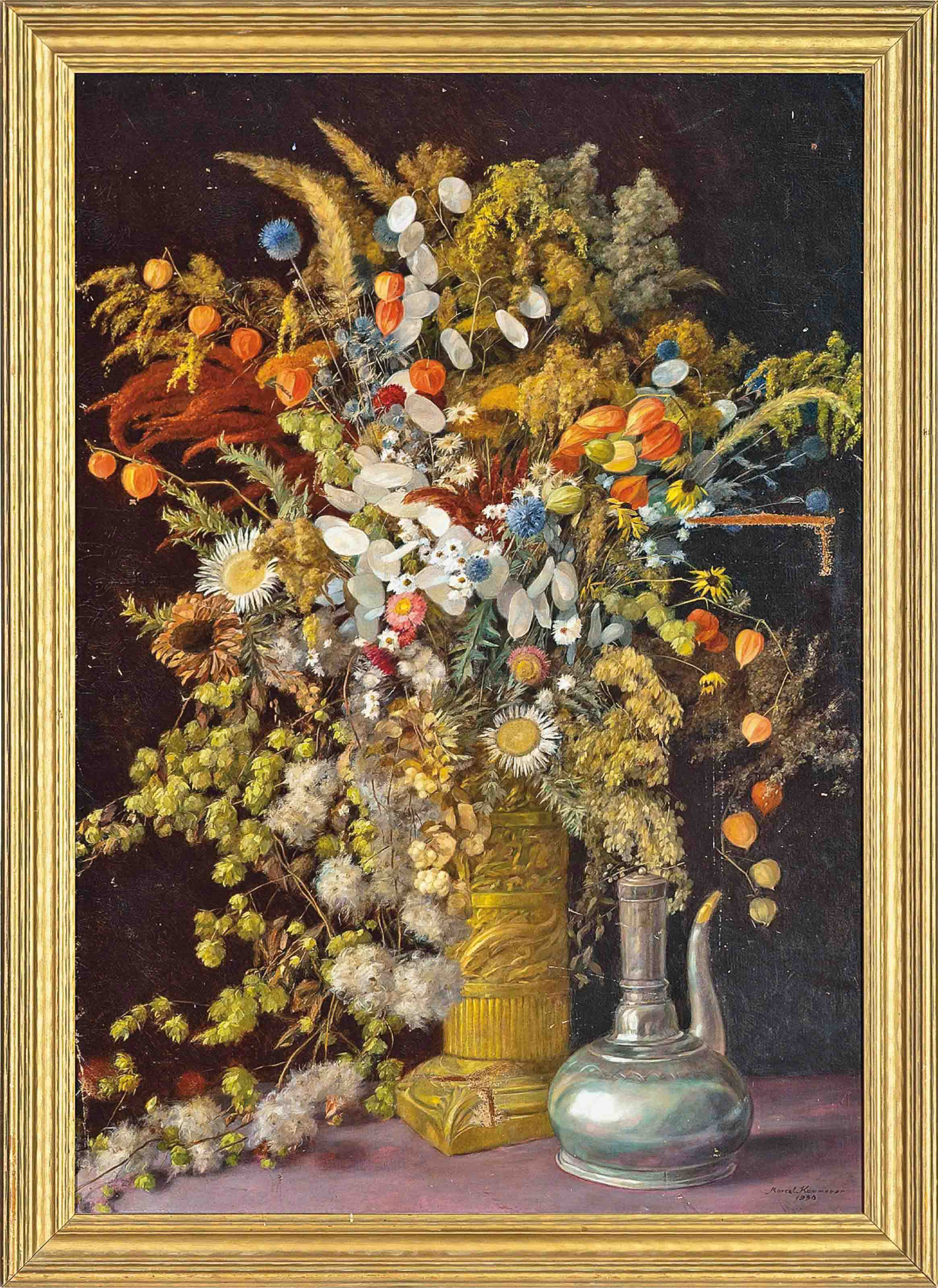 Dried summer flowers and grasses in an ornamental stone vase by a coffee pot