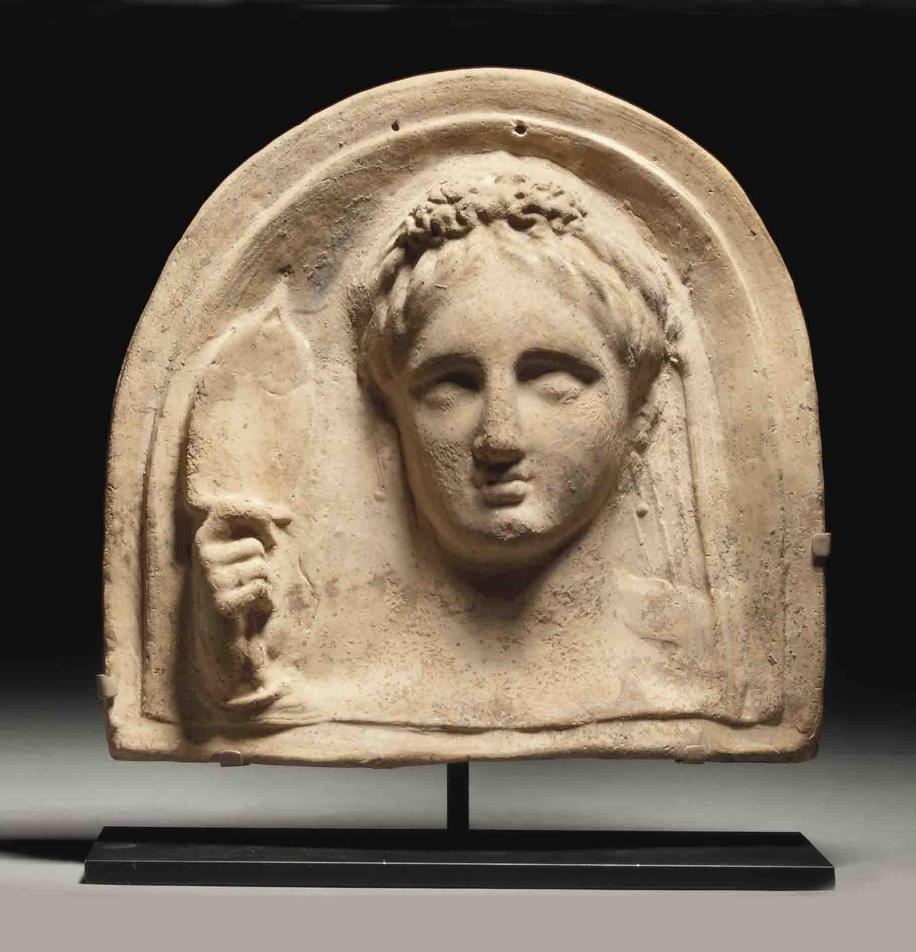 A GREEK TERRACOTTA FEMALE BUST PROTOME