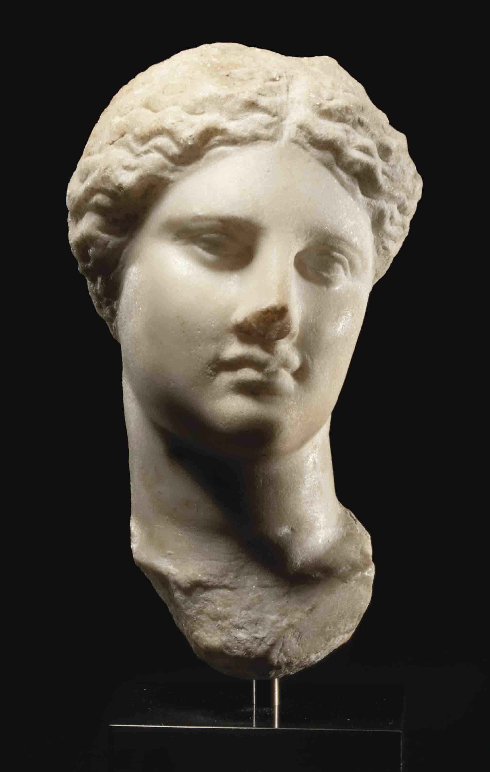 A GREEK MARBLE HEAD OF ISIS-APHRODITE | HELLENISTIC PERIOD