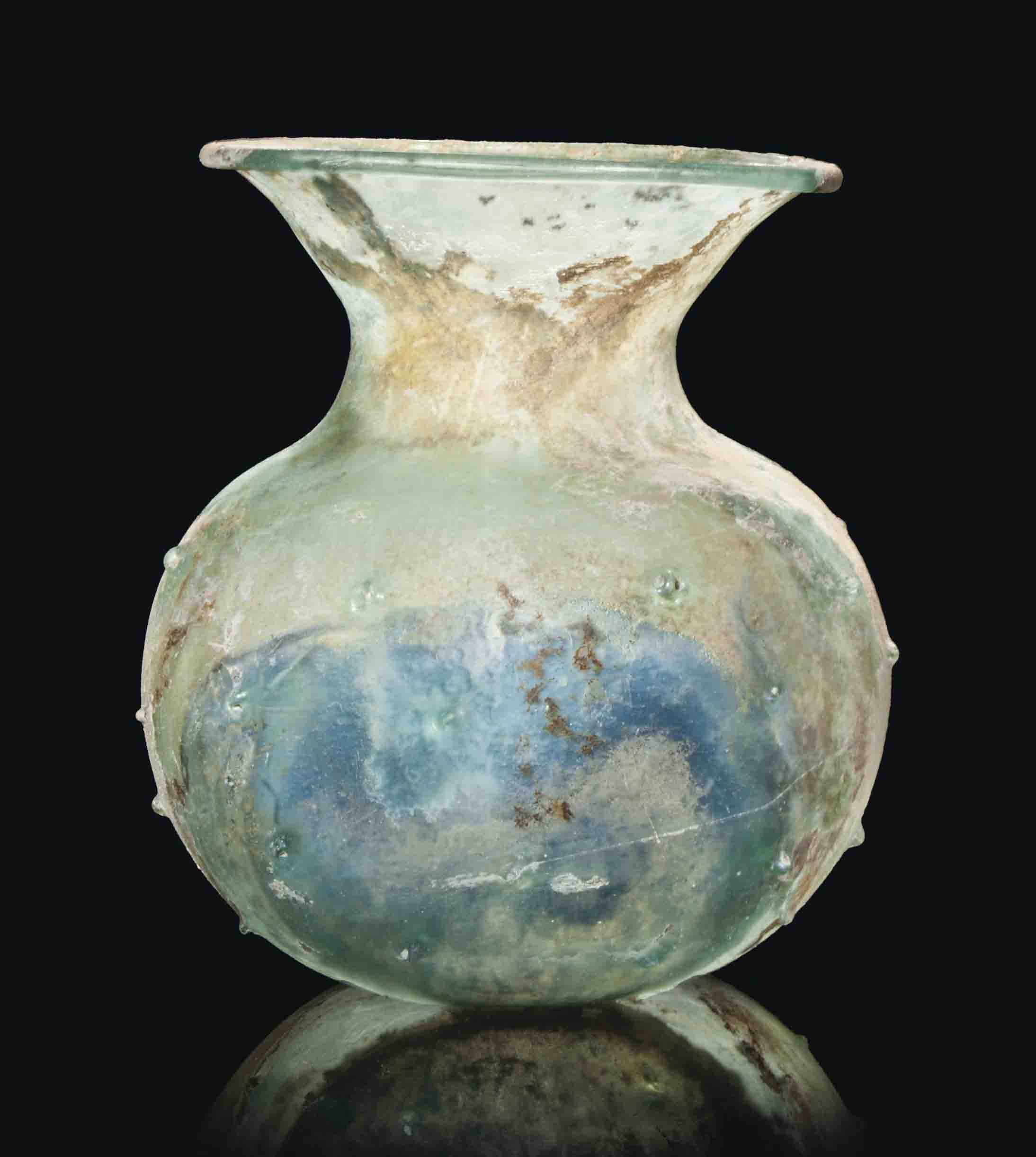 A ROMAN GREEN GLASS JAR