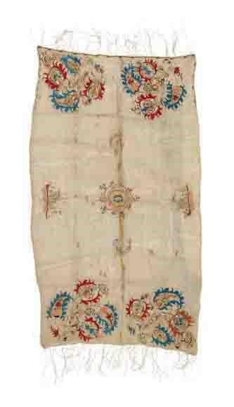 AN EMBROIDERED LINEN TOWEL