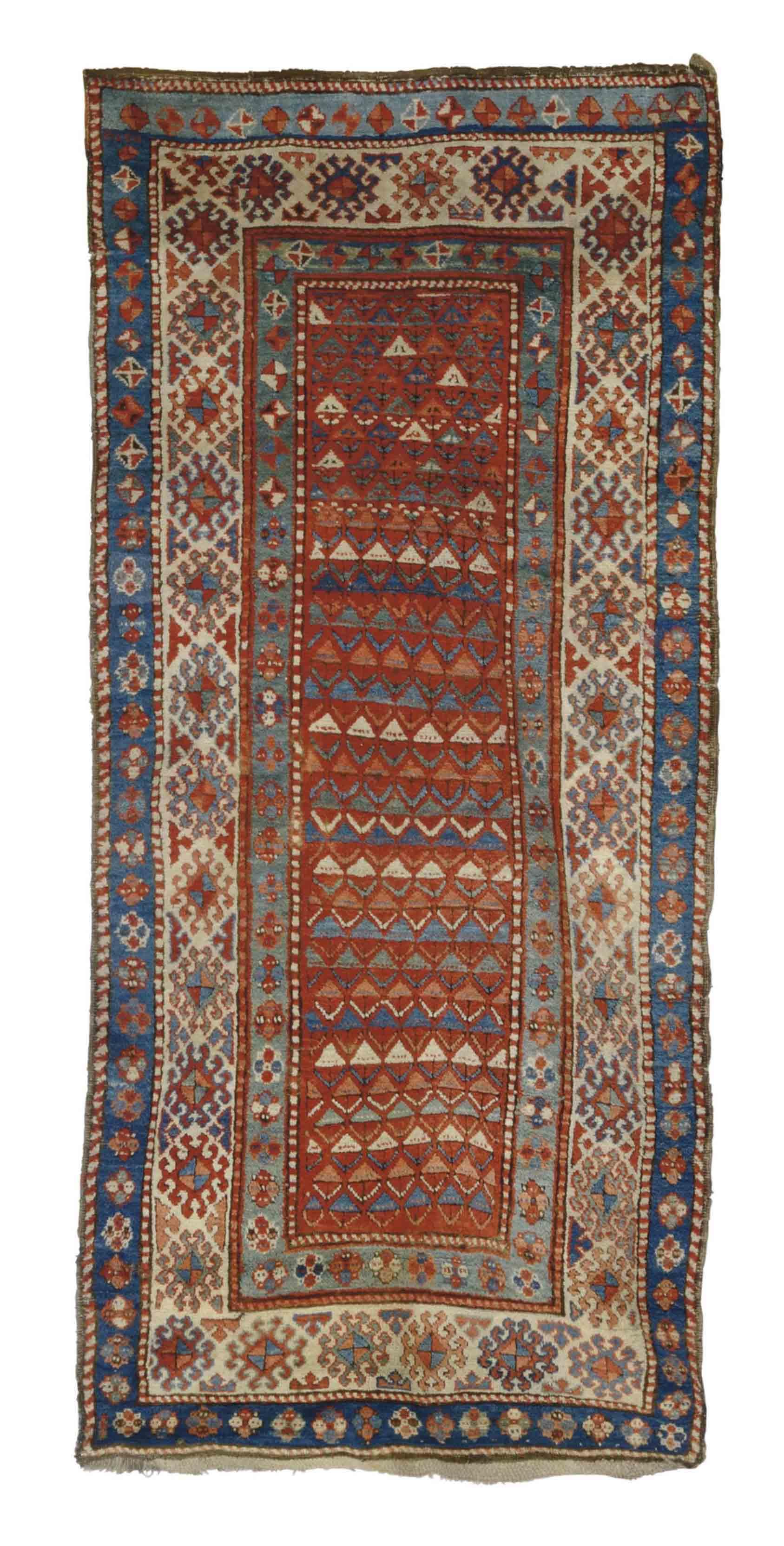 An antique Genje large rug