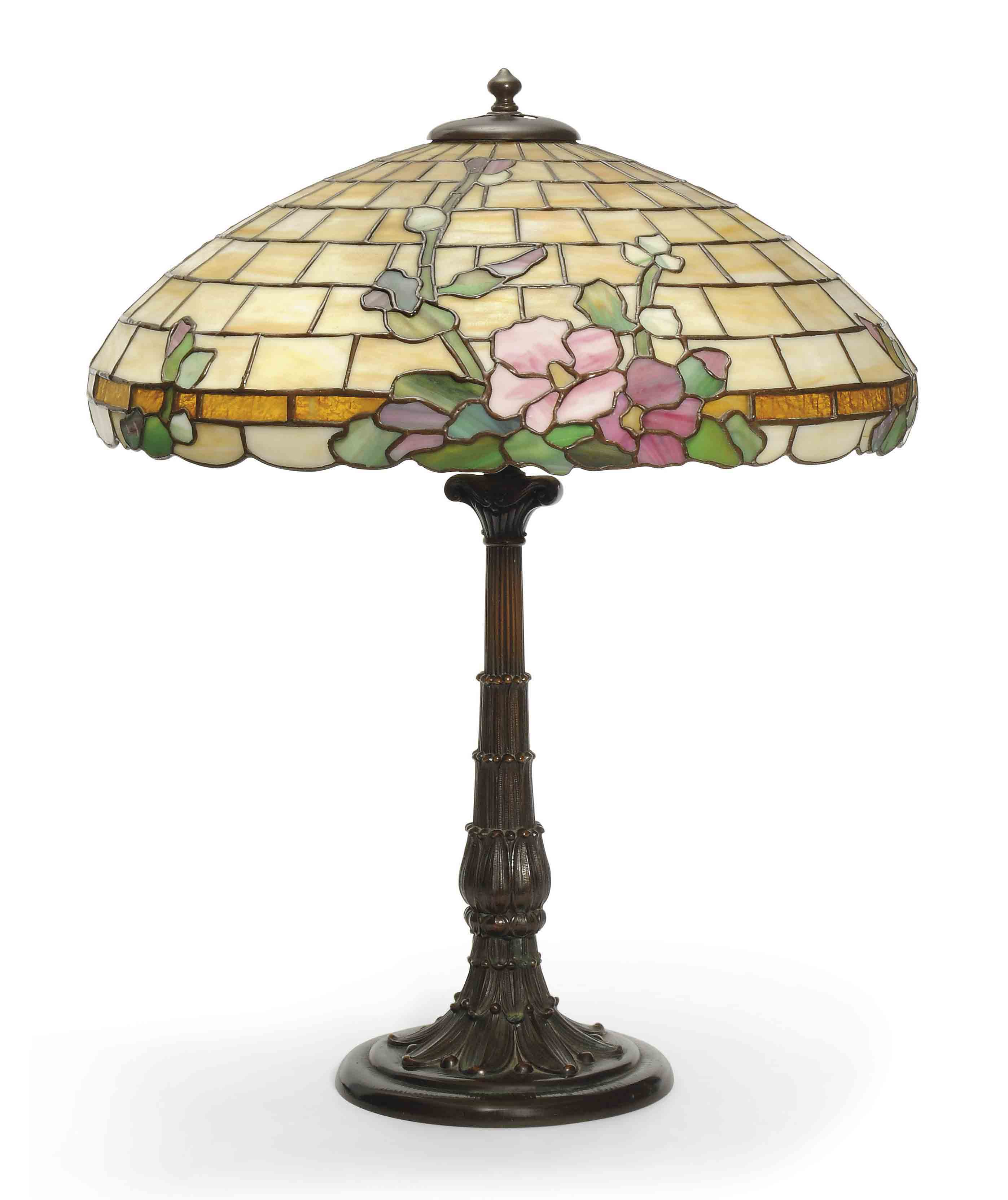 AN AMERICAN LEADED GLASS AND PATINATED METAL TABLE LAMP