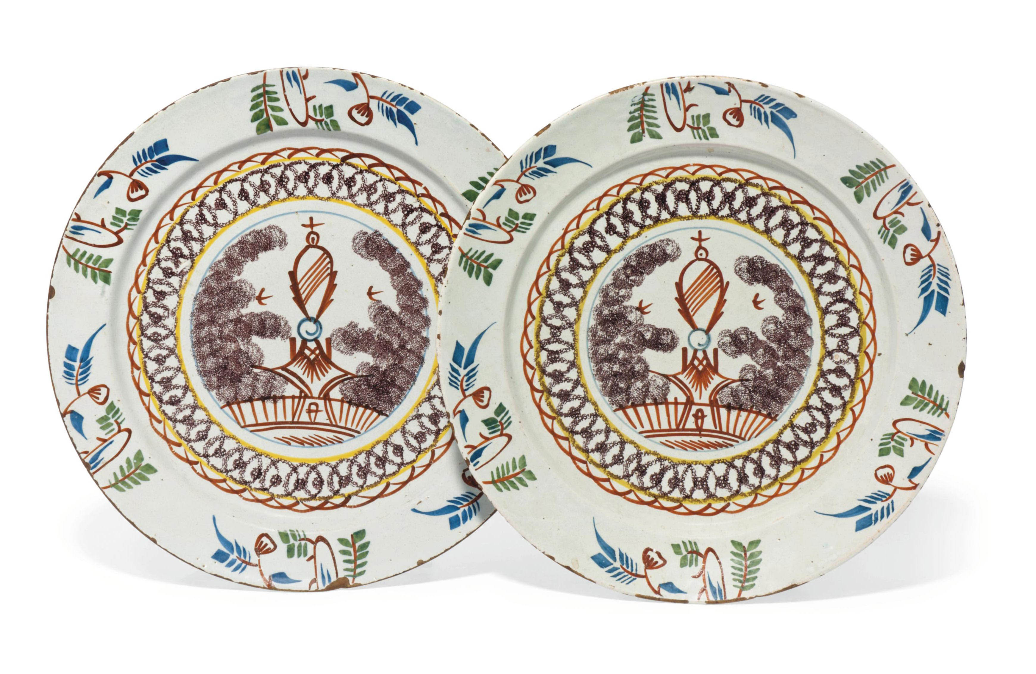 A PAIR OF ENGLISH DELFT POLYCHROME PLATES