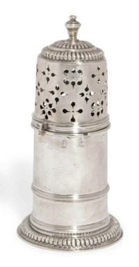 A WILLIAM III SILVER LIGHTHOUSE CASTER