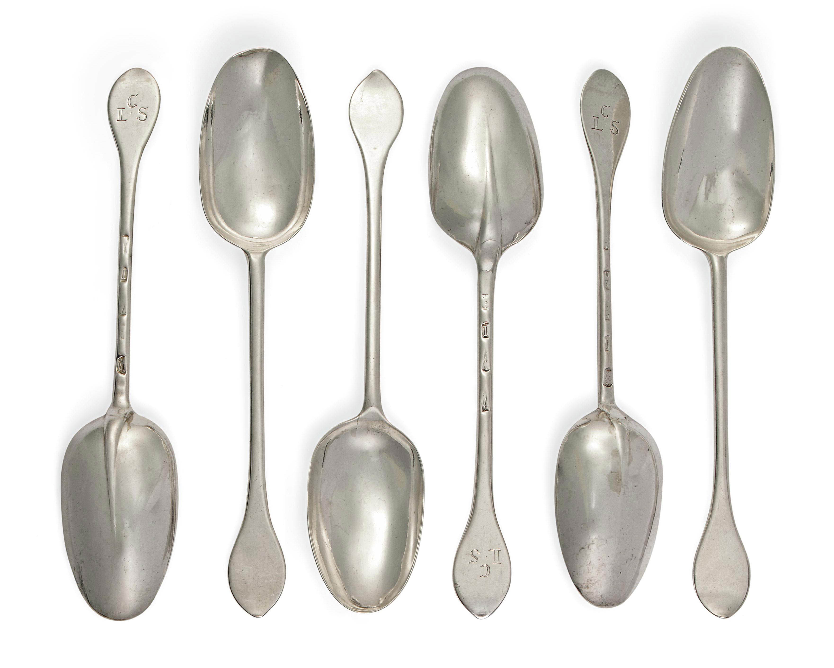 A SET OF SIX QUEEN ANNE PROVINCIAL SILVER WAVY END OR DOG-NOSE TABLE SPOONS