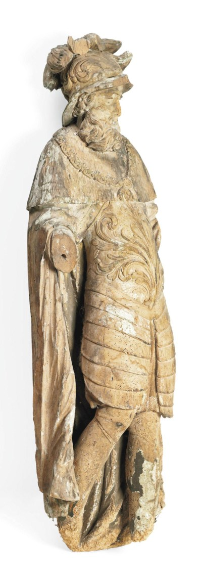 A CARVED LIMEWOOD FIGURE OF A