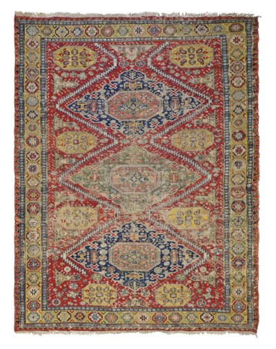 An antique Soumac carpet