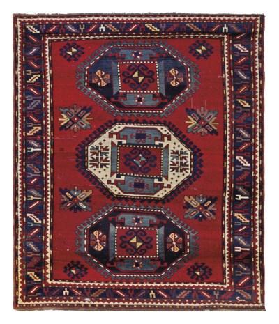 A Tripe Medallion Kazak rug