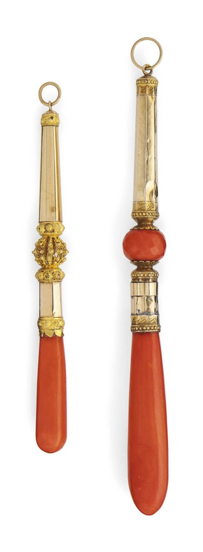 TWO GOLD AND CORAL TEETHERS