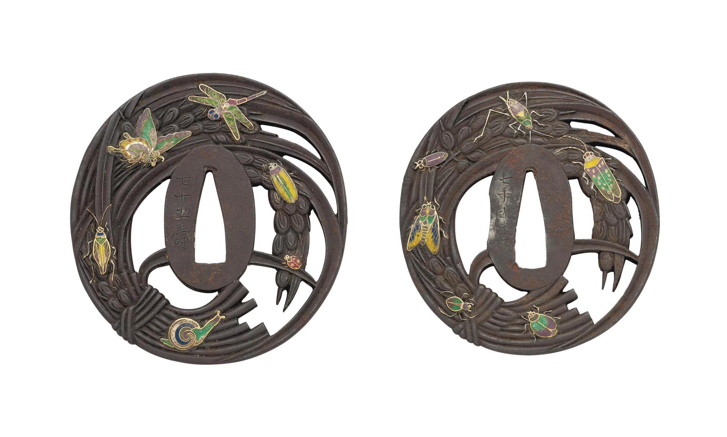 A Daisho Pair of Oval Iron Tsu