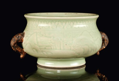 A CARVED CELADON-GLAZED CENSER