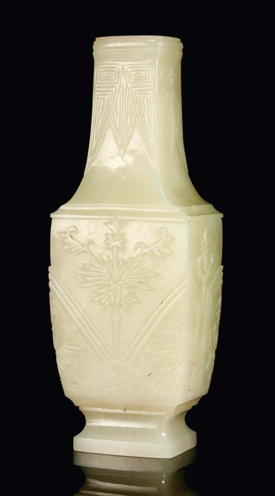A SMALL PALE CELADON JADE VASE
