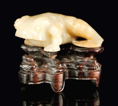 A CELADON JADE CARVING OF A TO