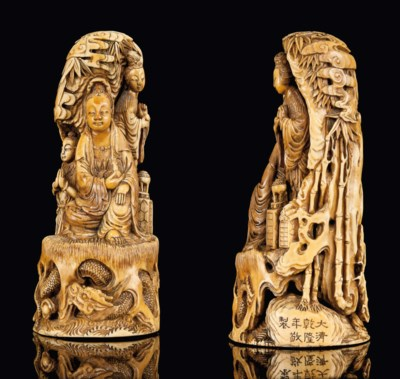 A STAINED IVORY CARVING OF A G