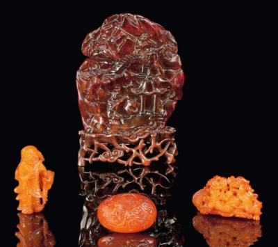 FOUR AMBER CARVINGS