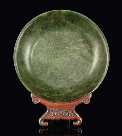 A LARGE SPINACH-GREEN JADE DIS