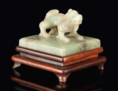 A CELADON AND RUSSET JADE SEAL