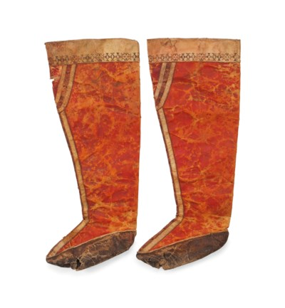 A PAIR OF HIGH TOPPED BOOTS