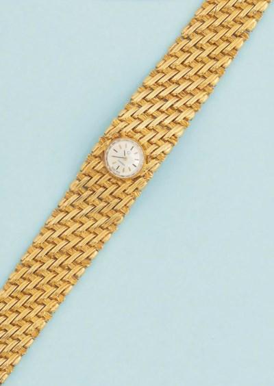 A lady's bracelet watch, by Om