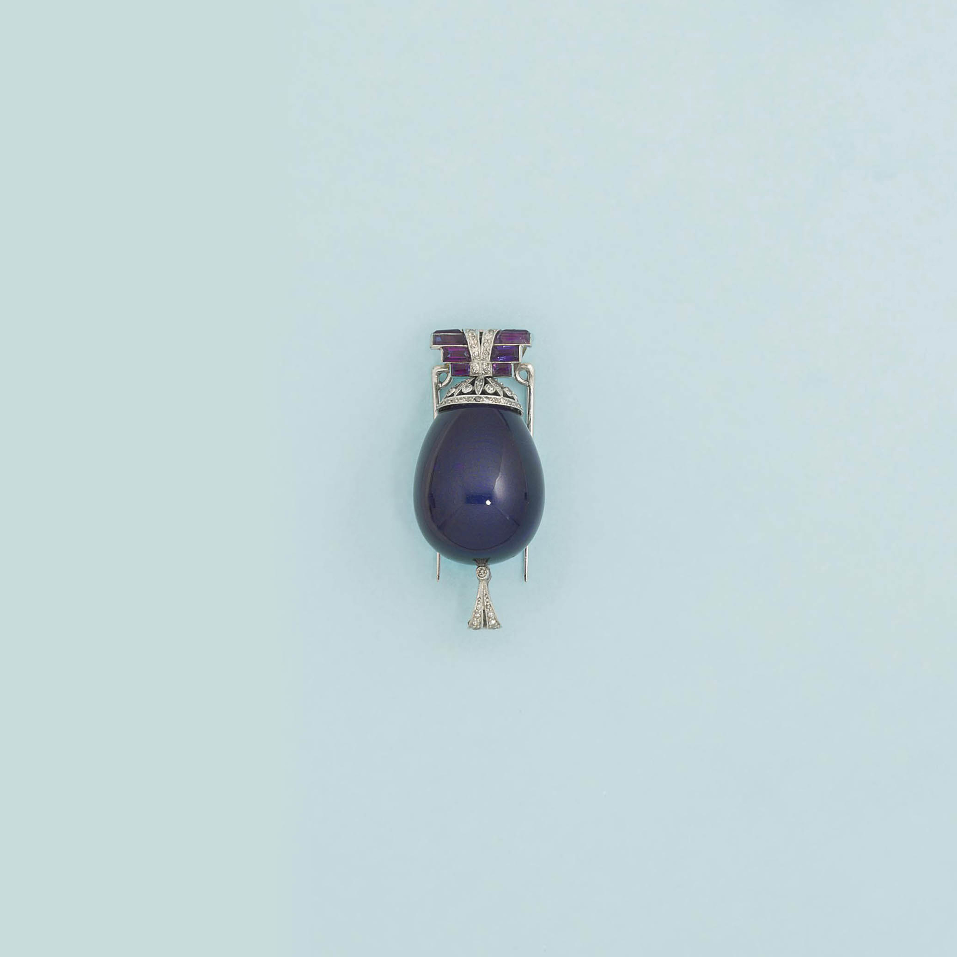 An Art deco amethyst and diamond brooch/pendant