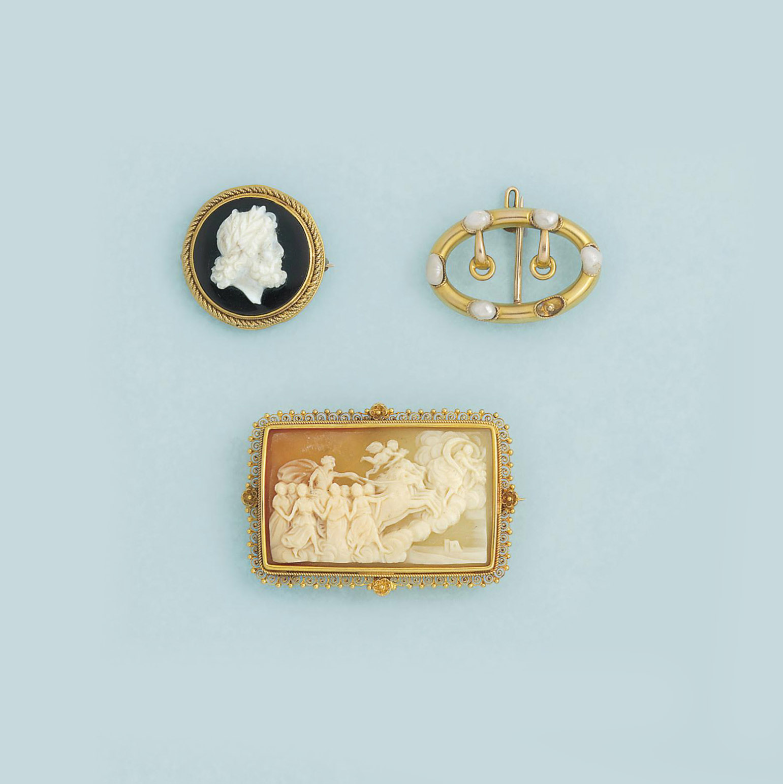 A collection of eight brooches