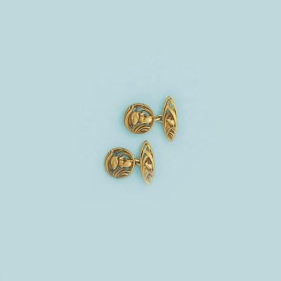 A pair of Art Nouveau gold cuf