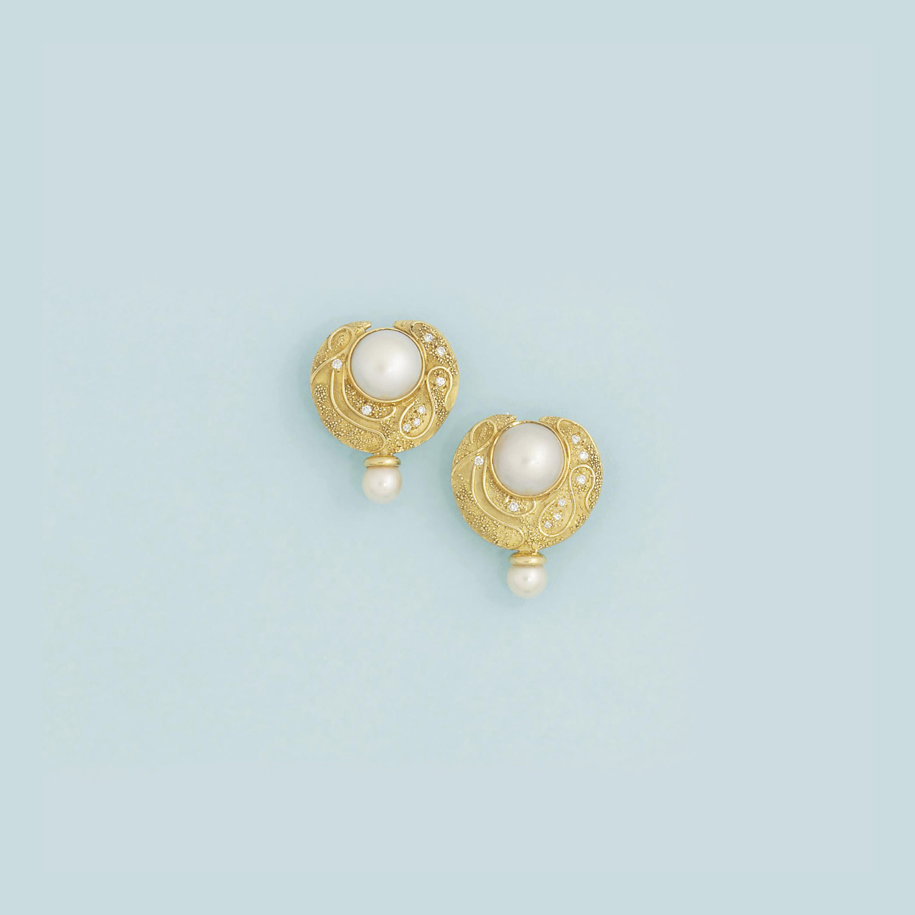 A pair of 18ct. gold cultured pearl and diamond earrings, by Elizabeth Gage