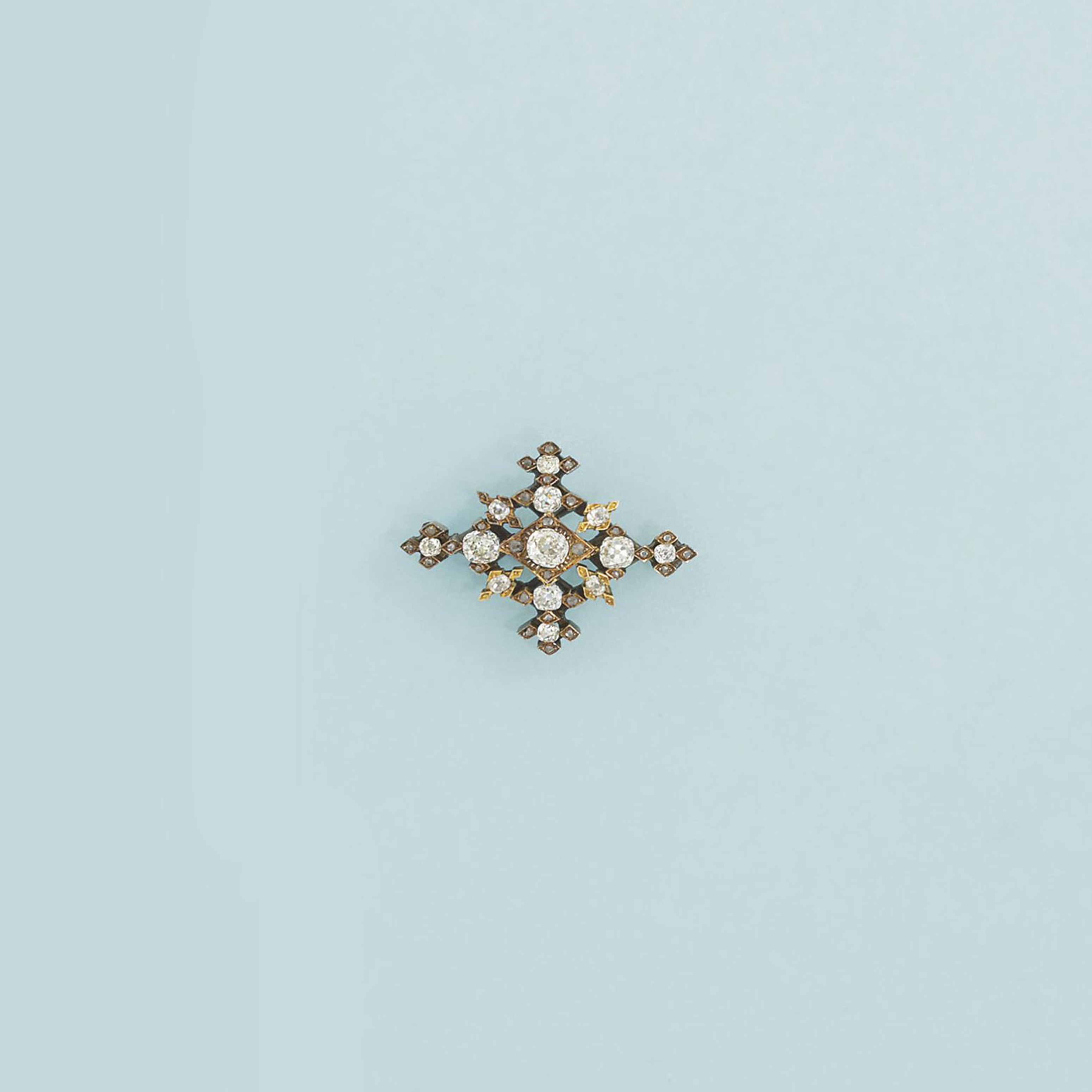A diamond brooch and a green p