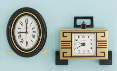 Two gilt metal clocks, by Cart