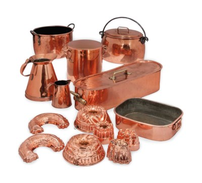 A GROUP OF COPPER COOKING PANS
