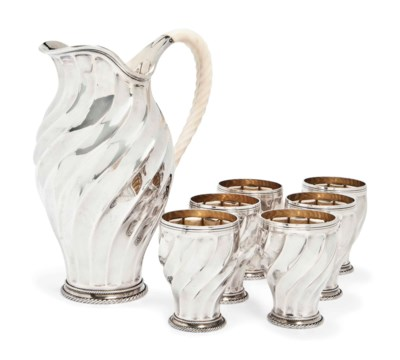 A GERMAN SILVER JUG AND SIX GO