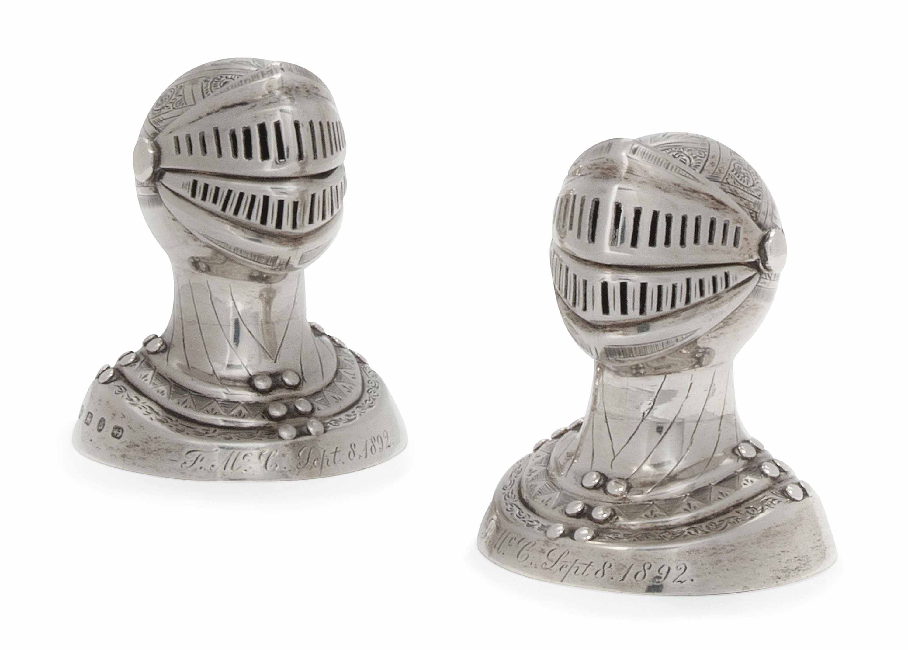 A PAIR OF VICTORIAN NOVELTY SILVER CONDIMENTS IN THE FORM OF VISORED HELMETS