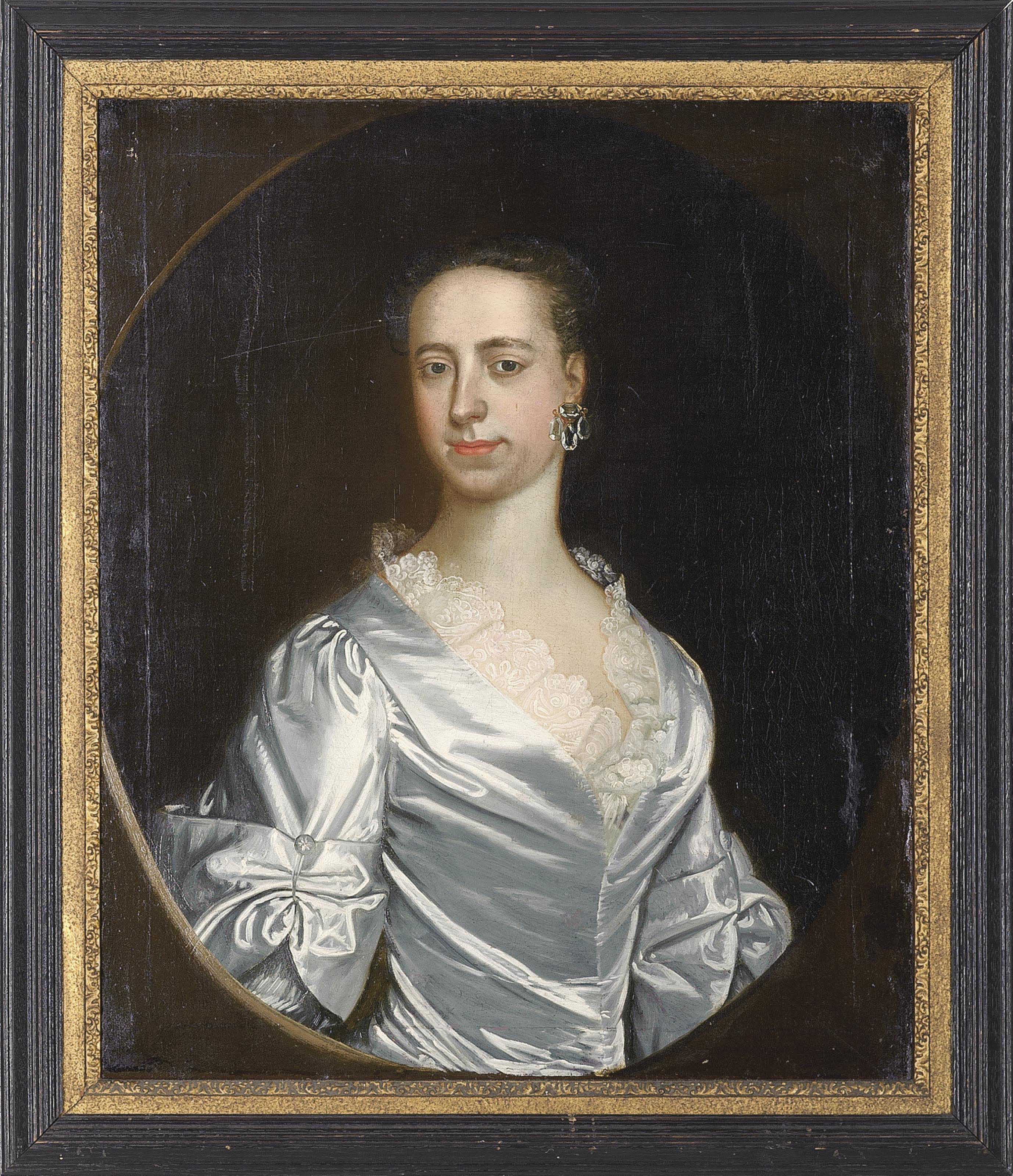 Portrait of a lady, half-length, in a light blue dress, feigned oval