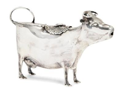 A MODERN SILVER COW CREAMER IN