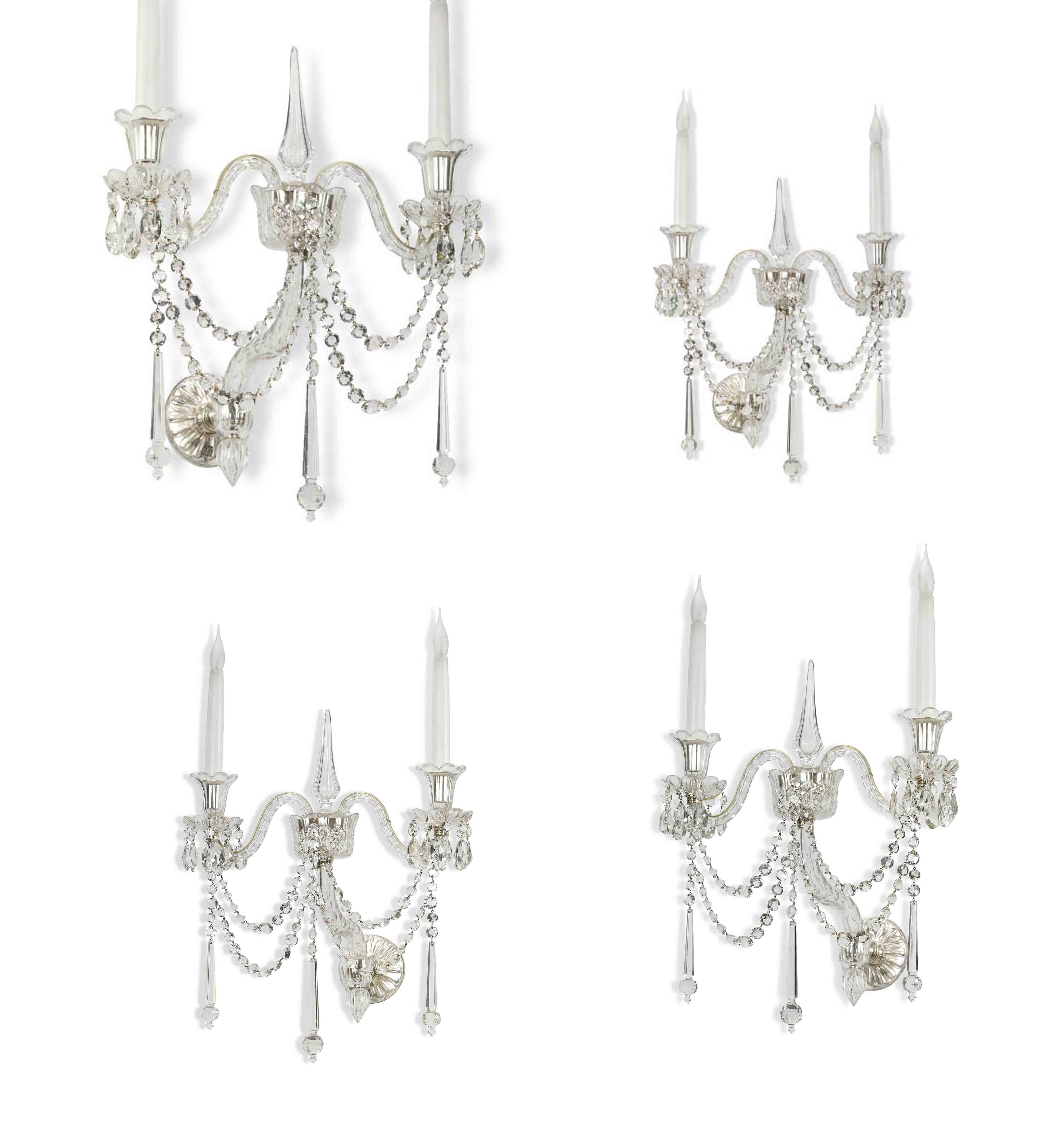 A SET OF FOUR LATE VICTORIAN CUT-GLASS AND SILVER PLATED TWIN LIGHT WALL APPLIQUES