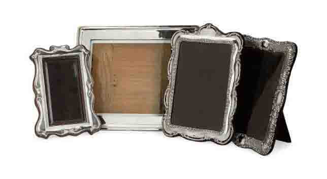 A GROUP OF THREE EDWARDIAN SILVER PHOTOGRAPH FRAMES