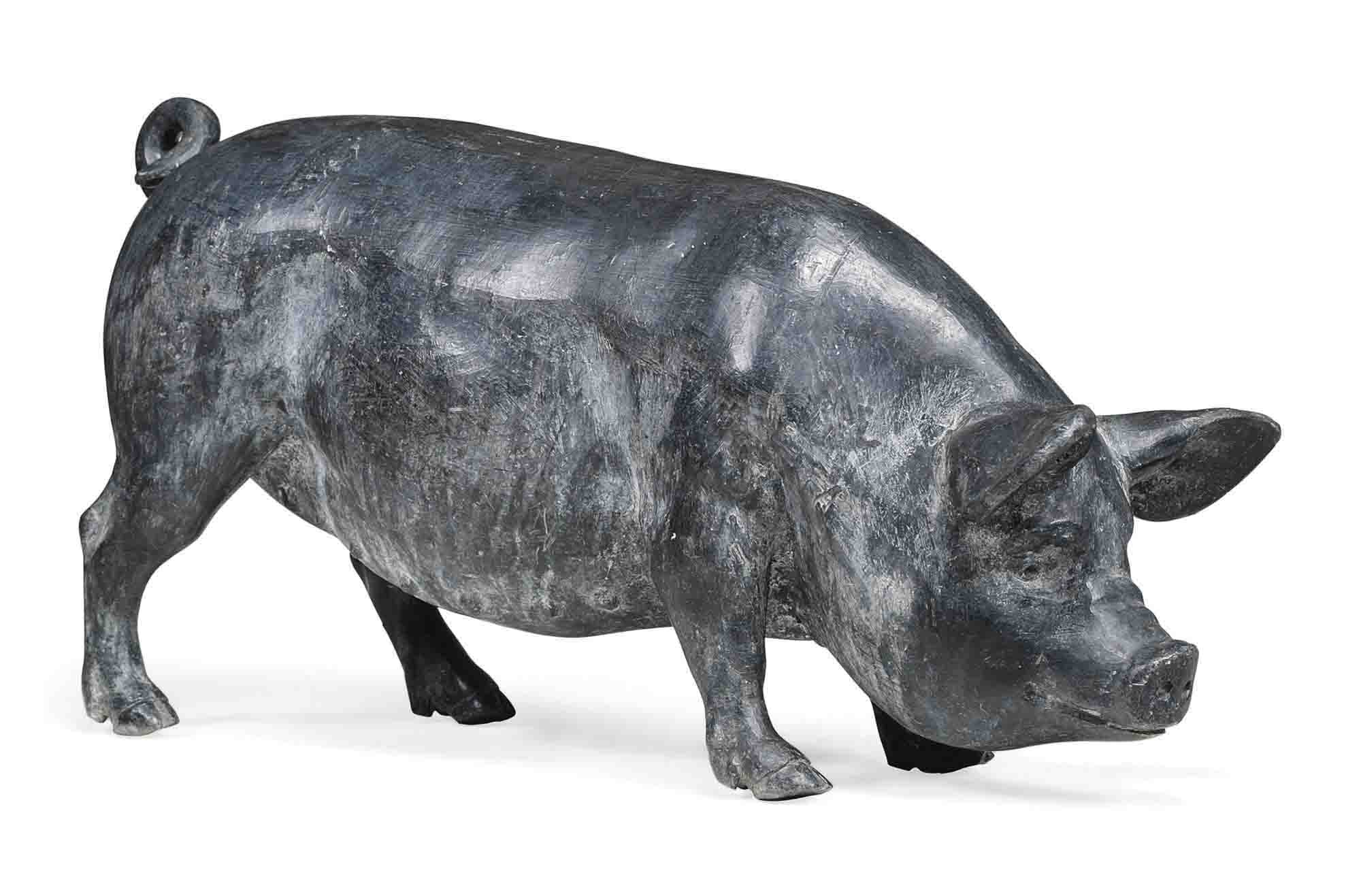 A LEAD MODEL OF A PIG