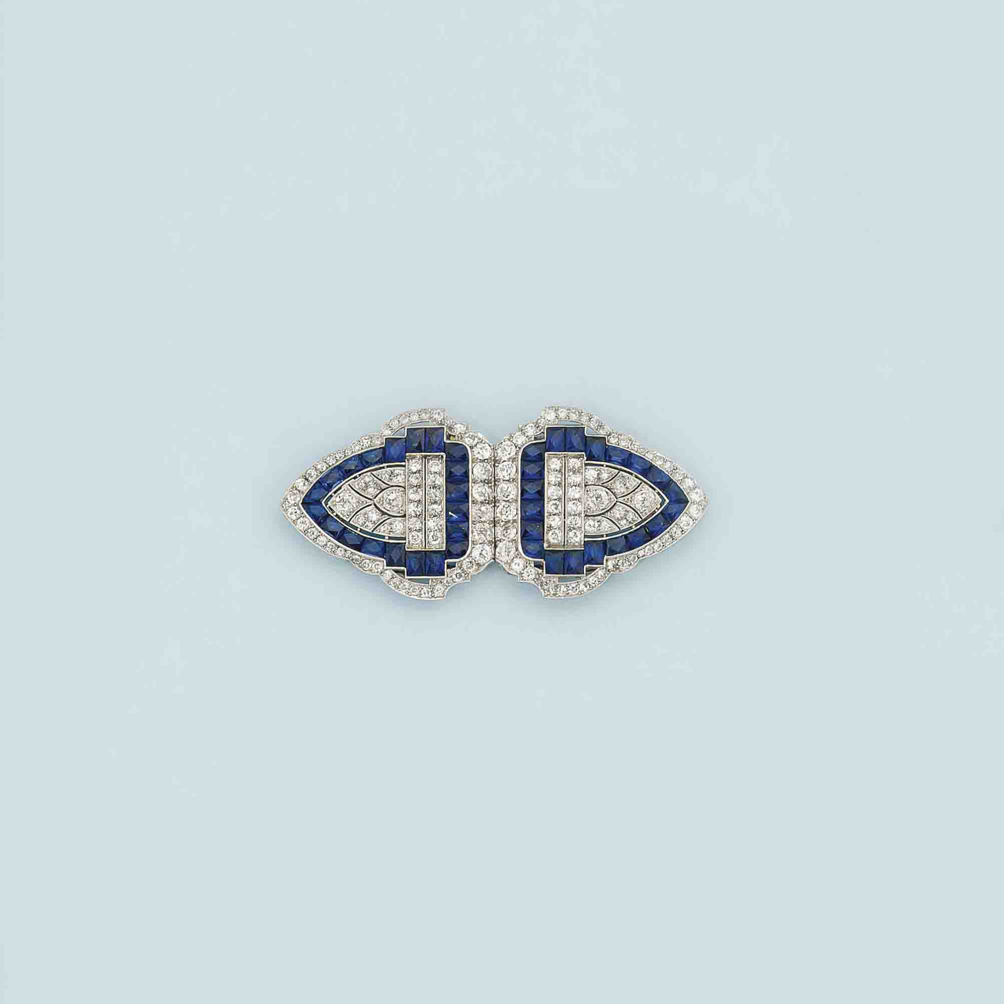 An Art Deco diamond and synthetic sapphire double clip brooch