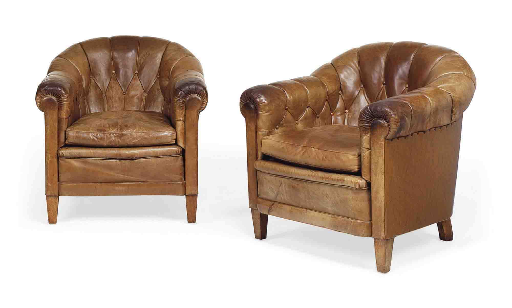 A PAIR OF FRENCH  BUTTONED LEATHER OAK ARMCHAIRS
