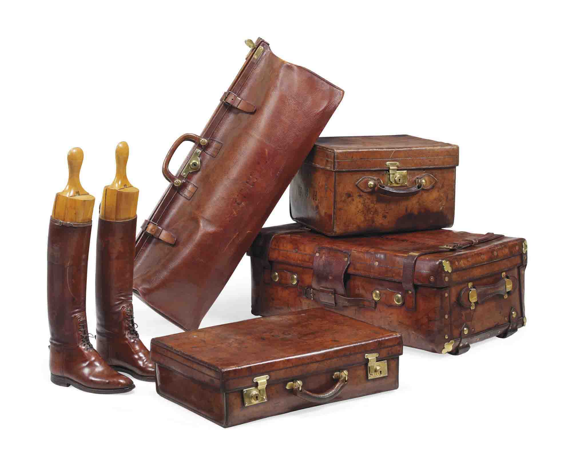 A GROUP OF FOUR VICTORIAN PIECES OF LEATHER LUGGAGE