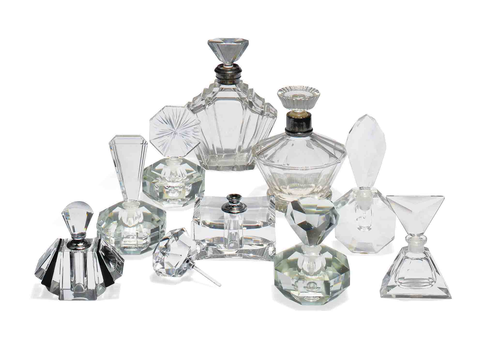 A COLLECTION OF ART DECO STYLE GLASS BOTTLES AND STOPPERS