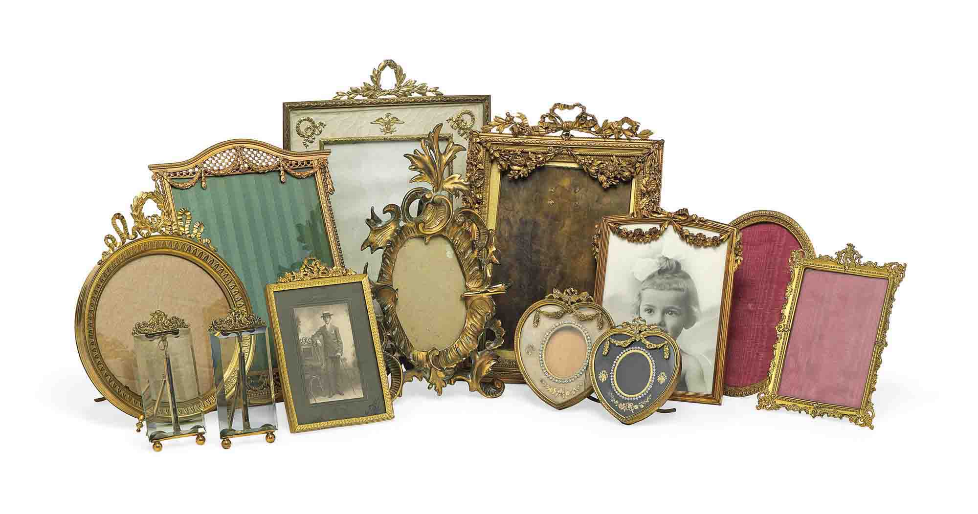 A GROUP OF TWELVE FRENCH ORMOLU-MOUNTED PICTURE FRAMES