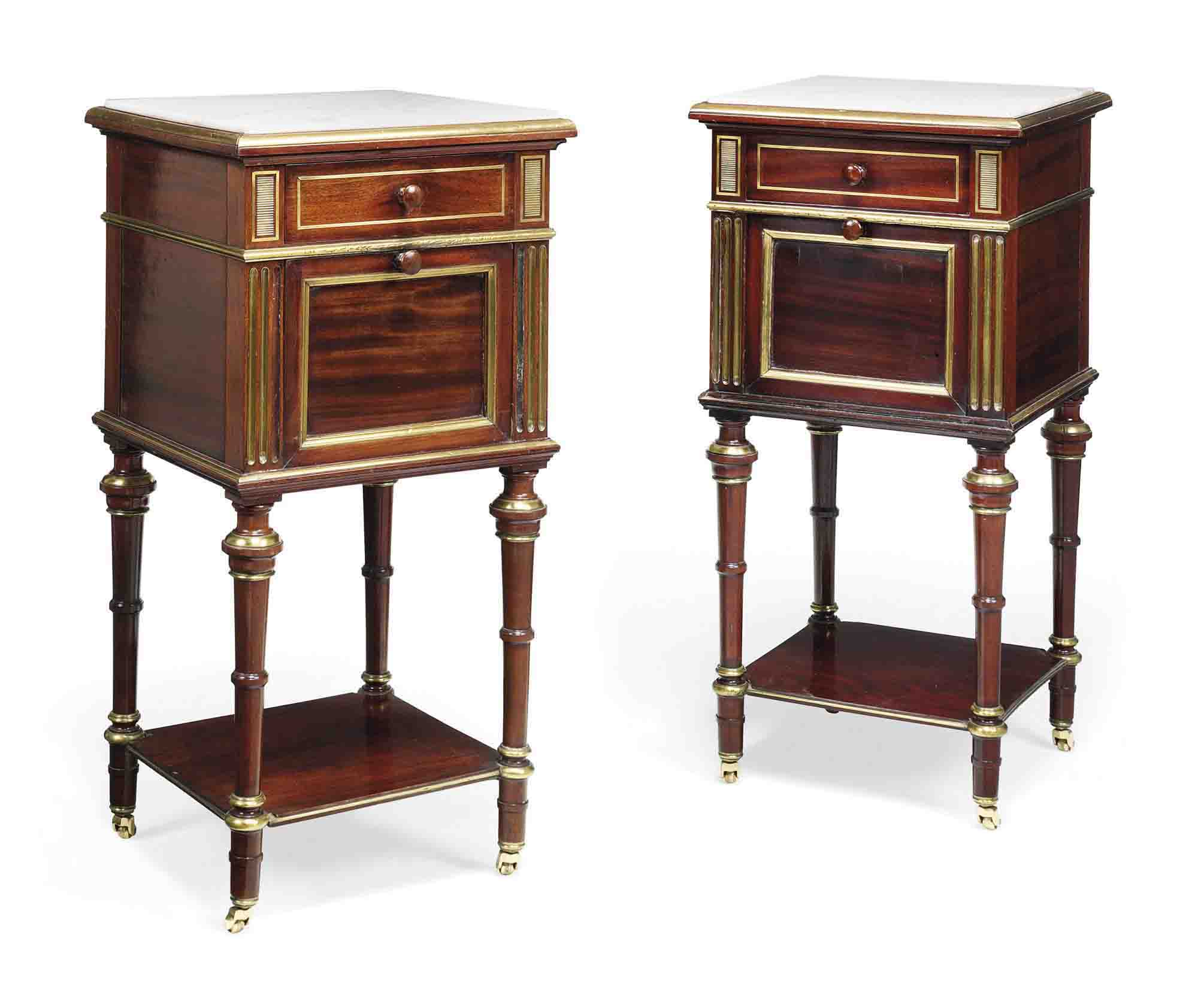 A PAIR OF FRENCH BRASS MOUNTED MAHOGANY BEDSIDE CABINETS