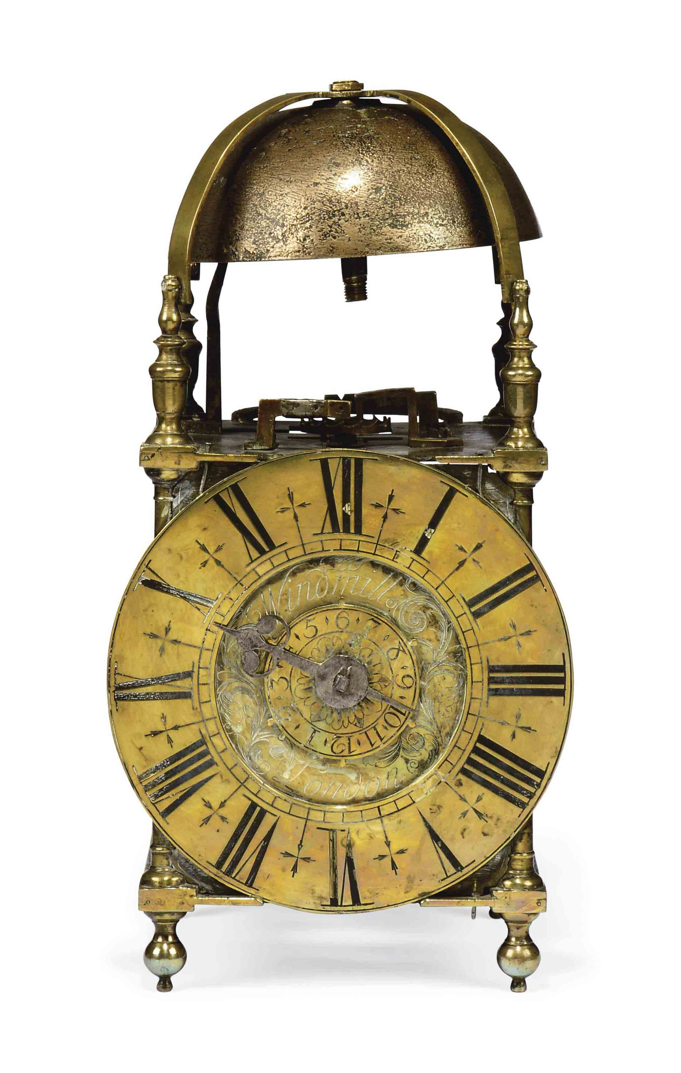 AN ENGLISH BRASS STRIKING LANTERN CLOCK