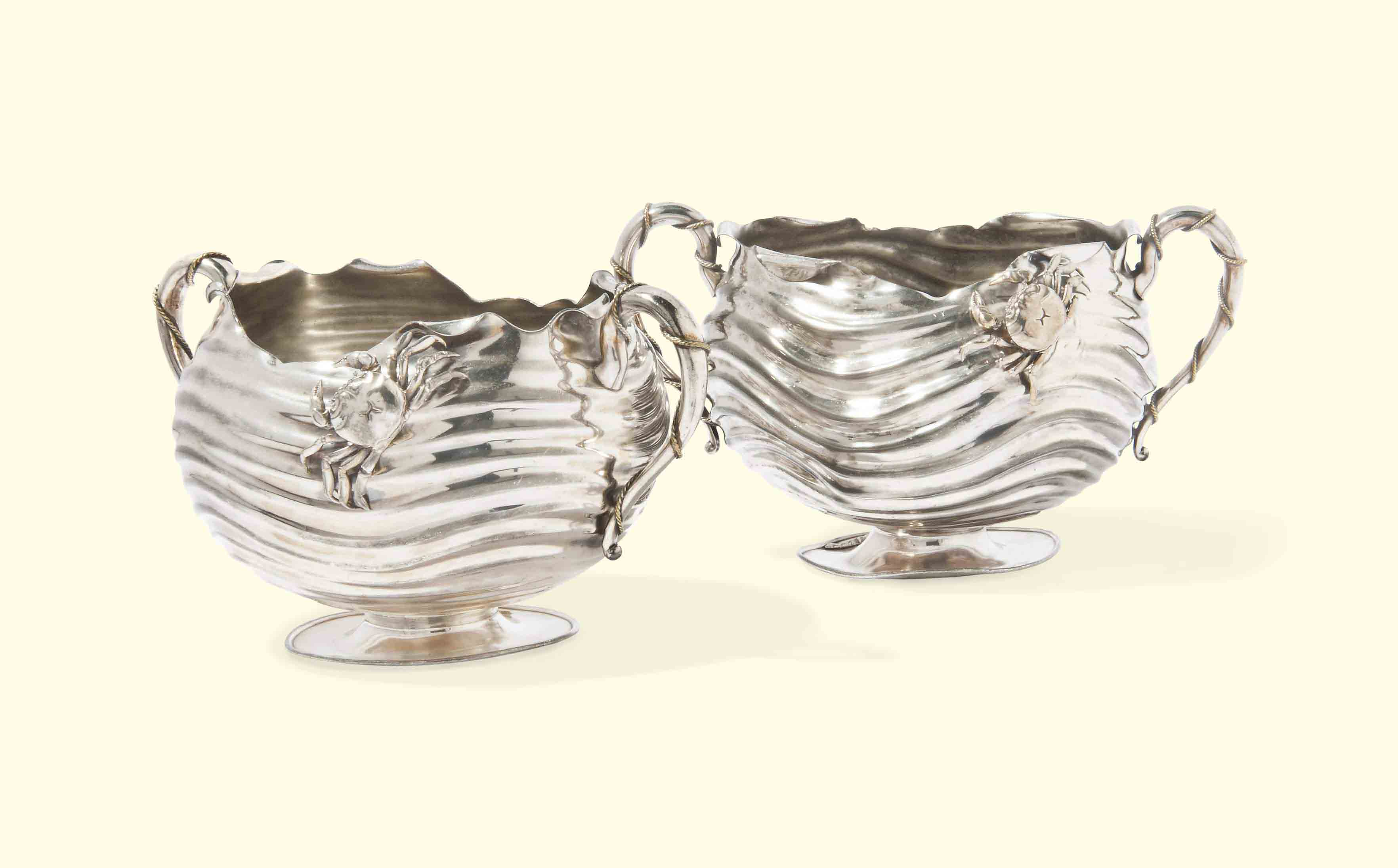 A PAIR OF AMERICAN ELECTROPLATED TWO-HANDLED BOWLS OF NAUTICAL DESIGN