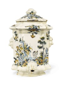 A SPANISH FAIENCE POLYCHROME WALL CISTERN AND COVER